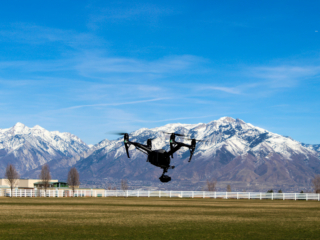 drone with mountain backdrop